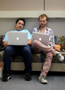 Roberto Escudero and Mario Garza work on their final project before graduating from FIU this December.
