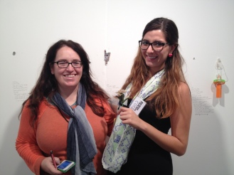 Kerry Phillips and I pose with her latest work at PULSE Contemporary Art Fair in Wynwood. Her work consisted of people exchanging things that had value to them. I gave some personal photos I carry in my wallet and I received a fake flower form a random guy.