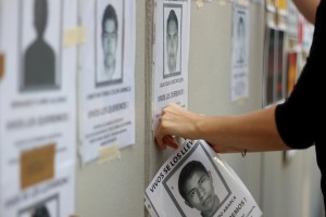 Protesters put up photos of the 43 missing students and later chanted justice for each of them.
